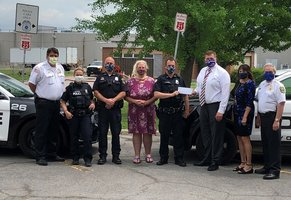 Tonawanda staff makes donation to Police Club